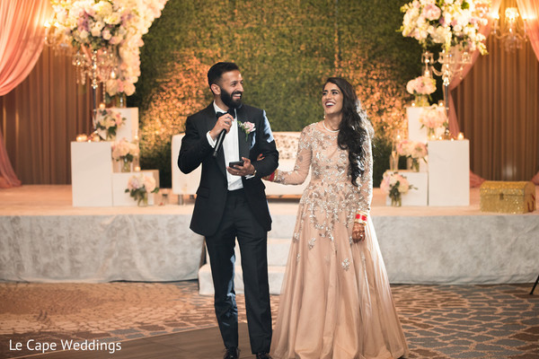 Indian newlyweds smile as speech time begins