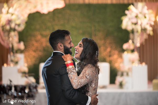 Indian groom holds his beautiful wife after the ceremony