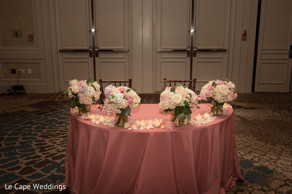 Floral arrangements wait for the Indian newlyweds and guests
