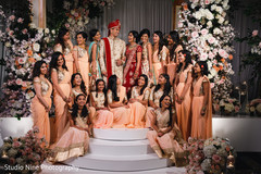 Capture of the Indian groom with the maharani and bridesmaids