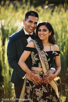 Striking portrait of the Indian newlyweds outdoors
