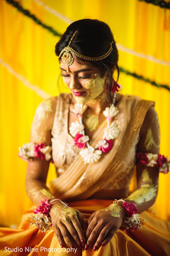Capture of the beautiful Indian bride after the haldi ceremony