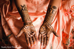 Detail of the mehndi design on the Indian bride's hands