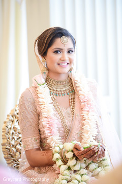 Glamorous Indian bride at her wedding ceremony ritual capture.