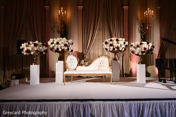 indian wedding reception stage,indian wedding reception roses decor