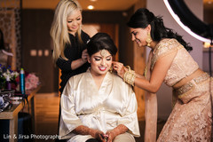 Indian bride getting ready for the ceremonies