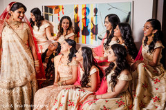 Indian bride before the ceremony with the beautiful bridesmaids