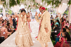 Fun capture of the Indian newlyweds dancing after the ceremony