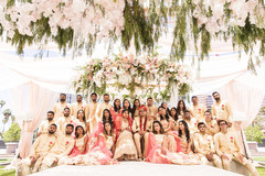 Amazing capture of the Indian couple with special guests and bridesmaids