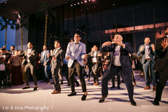 Special guests and groomsmen make a choreography