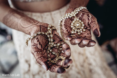 Indian bride showing her stunning jewelry.
