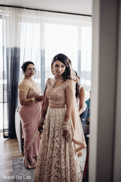 Dazzling Indian bride getting ready capture.