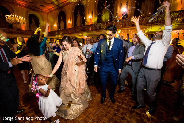 Indian newlyweds have a great time with their guests at the reception