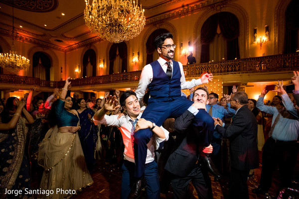 Indian groom is lifted as the party continues