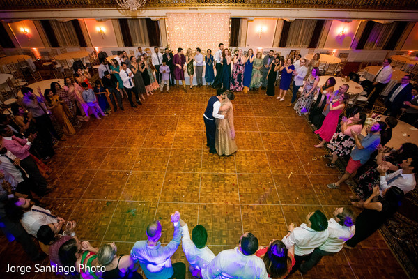 Incredible overview of guests surrounding the Indian newlyweds