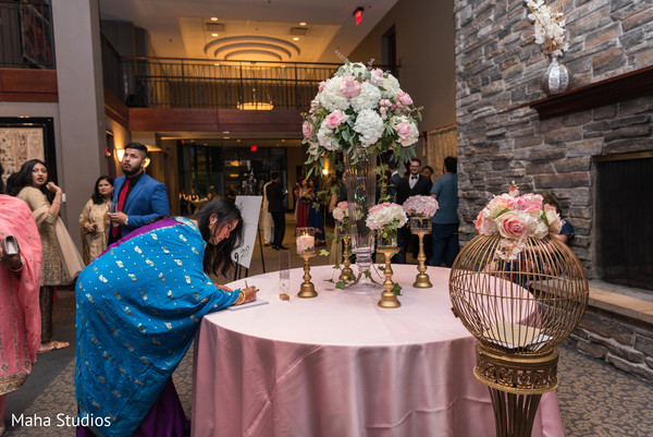 Indian wedding guest leaving a note