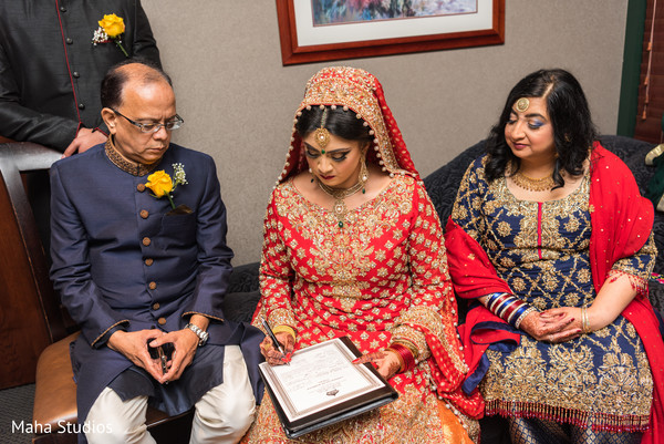 Adorable indian bride signing wedding contract