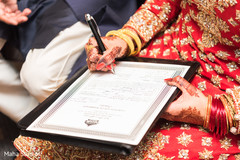Indian bride signing wedding contract