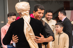 Indian wedding guests congratulating the groom