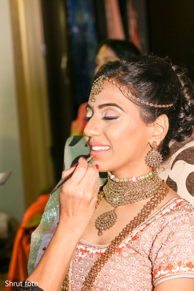 Enchanting maharani being assisted by the makeup artist