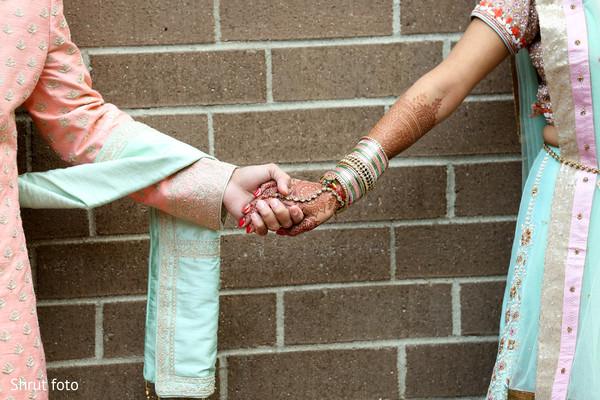 Indian bride and groom holding hands for the photo shoot