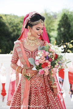 Lovely maharani holding her bridal bouquet