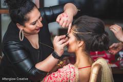 Makeup artist assisting the beautiful maharani