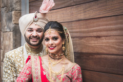 Indian bride and groom smile during the photo shoot