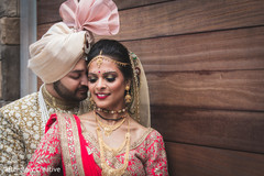 Indian groom and bride pose for pictures