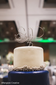 Indian wedding cake detail with the newlyweds initials