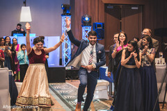 Special guests dance during the Indian wedding reception