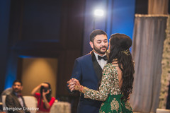 Indian newlyweds dance as the reception begins