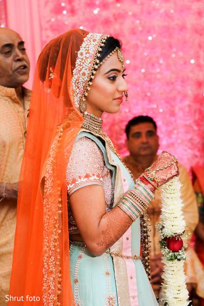 Stunning maharani with the mehndi holding the flower garland