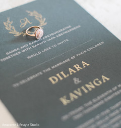 Close up of the Indian wedding invitation and ring
