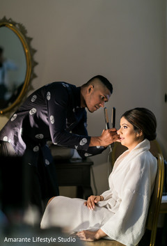 Maharani being assisted with her hair prior to the Indian wedding