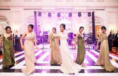 Beautiful bridesmaids perform a choreography for the Indian couple