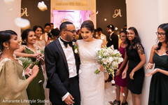 Joyful Indian newlyweds as they make their entrance