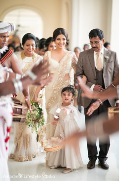 Stunning maharani making her entrance escorted by her parents