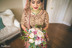 Lovely indian bride holding her bouquet