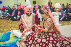 Sweet indian couple exchanging rings