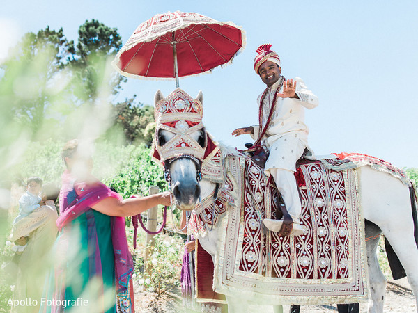 Indian groom arrives to the ceremony riding the Ghodi