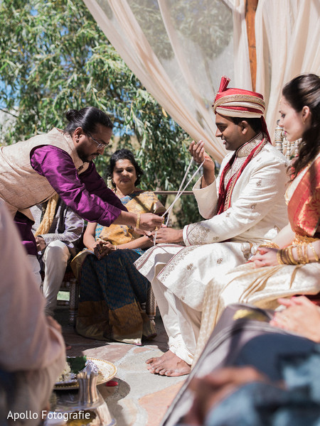 Indian groom and bride during a moment of the Indian wedding celebration