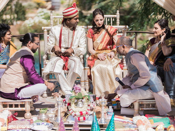 Indian wedding ceremony happening as both families observe