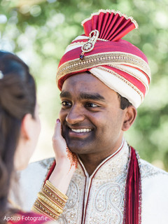 Indian groom staring at his beautiful wife during the photo shoot