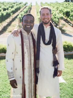 Indian groom taking a picture with a special guest