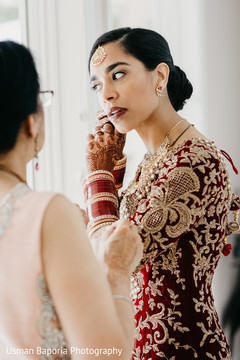 Stunning maharani getting ready prior to the Indian wedding