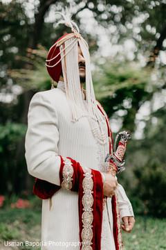 Elegant portrait of the Indian bride wearing the sherwani