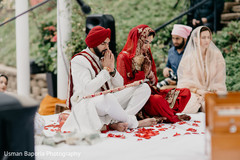 Indian bride and groom during a moment of the ceremony