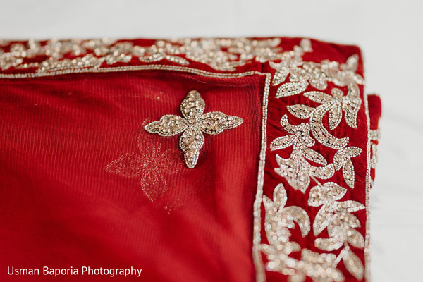 Gems detail on the fabric used for the Indian wedding