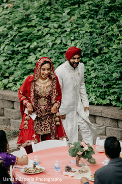 Indian wedding couple together visiting the guests tables